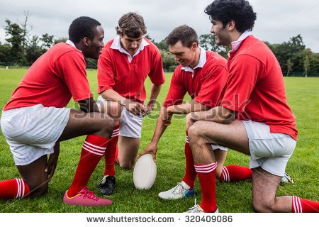 stock-photo-rugby-players-discussing-tactics-before-match-at-the-park-320409086