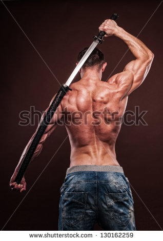 stock-photo-shirtless-young-man-posing-with-katana-sword-130162259
