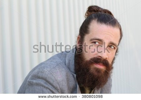 stock-photo-stylish-bearded-hipster-model-with-man-bun-hairstyle-lifestyle-in-the-street-depth-of-field-copy-380801098